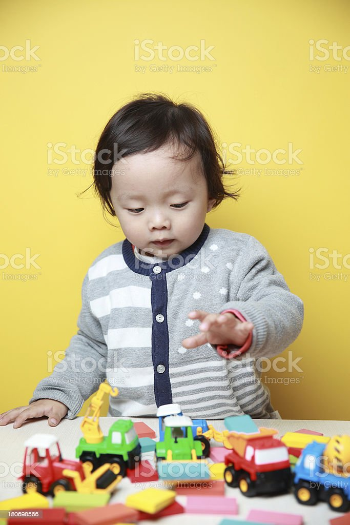 cute baby play with toys royalty-free stock photo