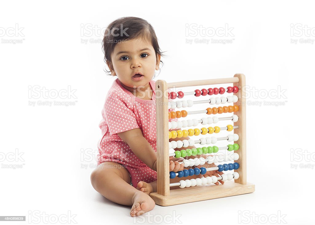 Cute baby playing with abacus stock photo