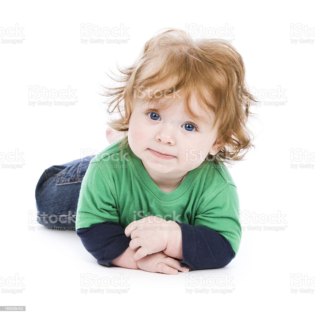 Cute baby red haired boy lying on white background royalty-free stock photo