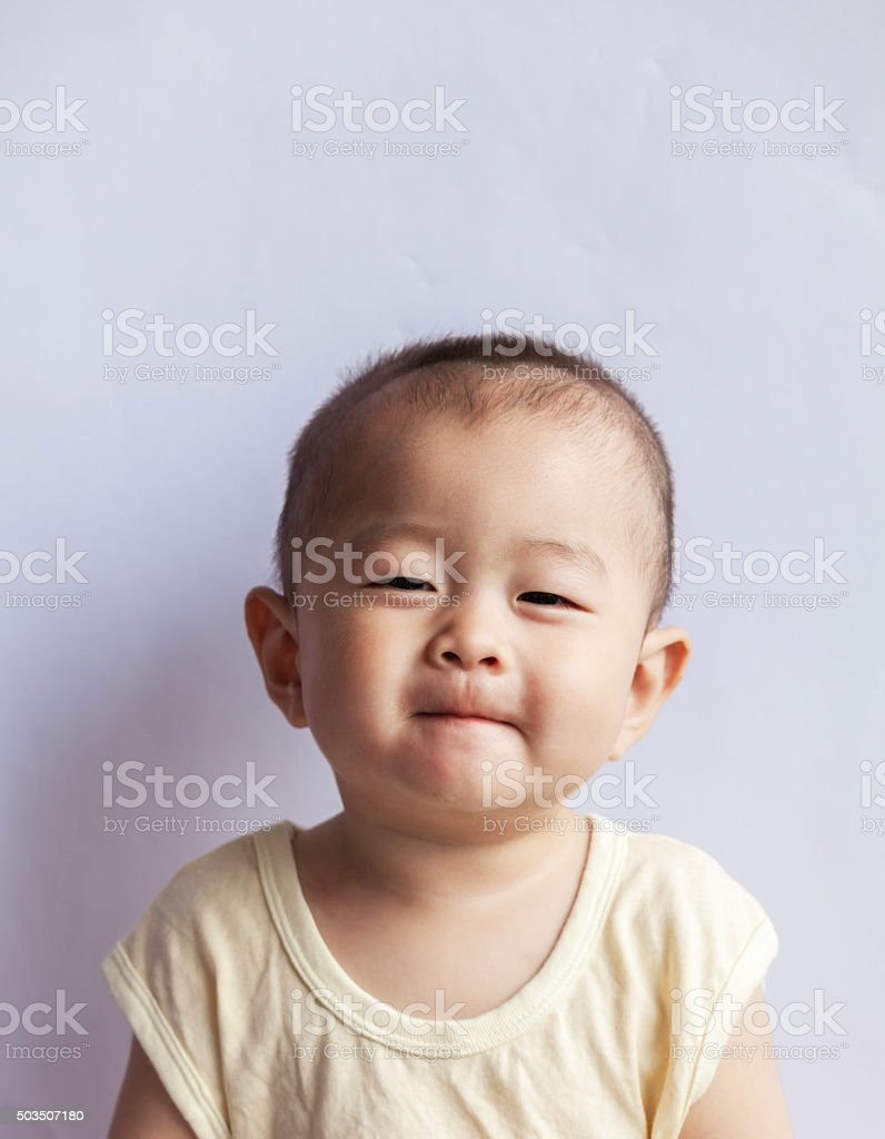 Cute baby smile with biting lip stock photo