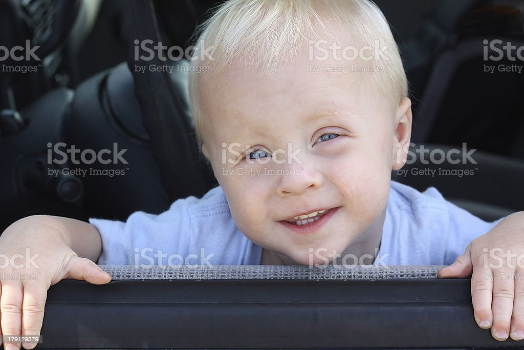 Cute Baby Smiling from Car Window royalty-free stock photo