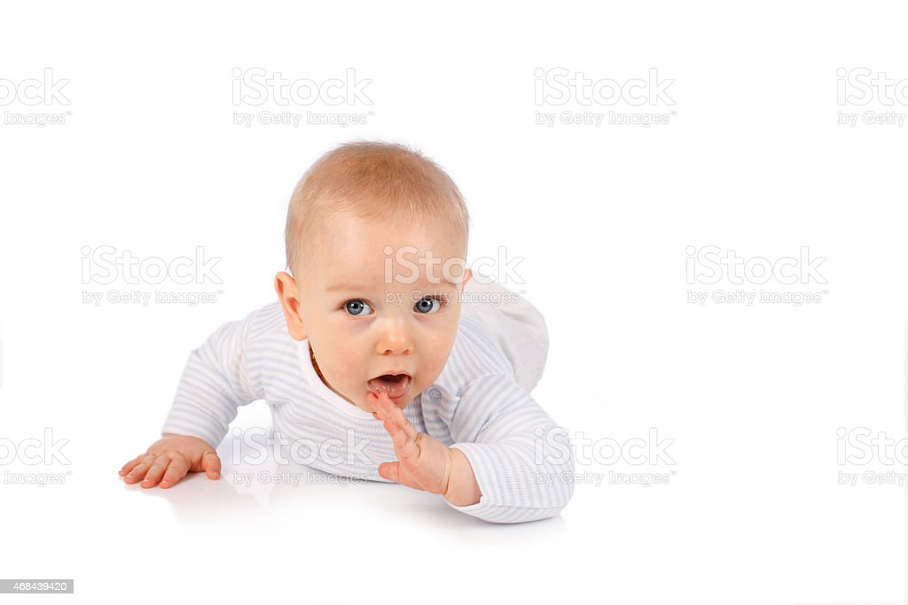 Cute baby tries to crawl stock photo