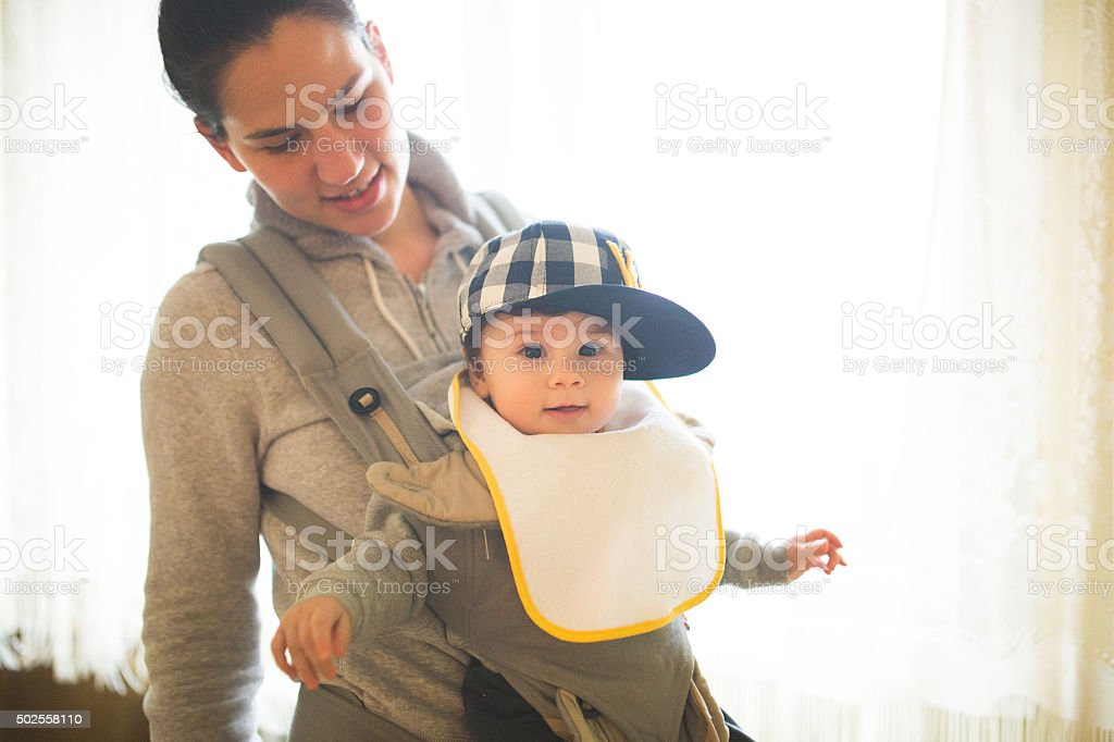 Cute baby with big cap stock photo