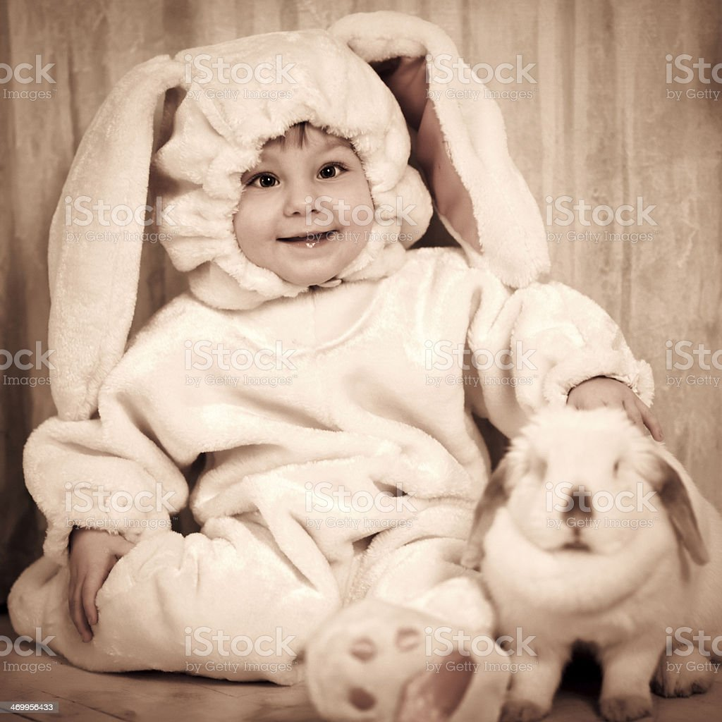 Cute baby with Easter bunny stock photo
