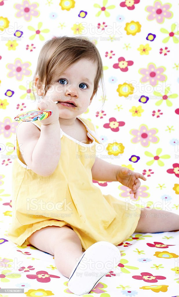 Cute baby with lollipop royalty-free stock photo