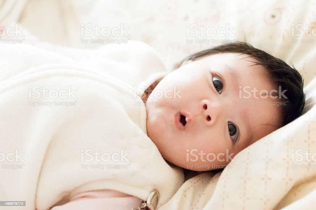Cute baby with surprized expression stock photo