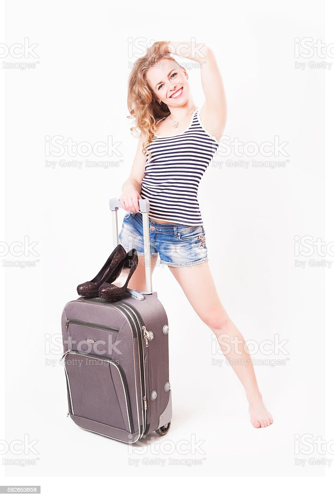 Cute beautiful young woman with a suitcase stock photo