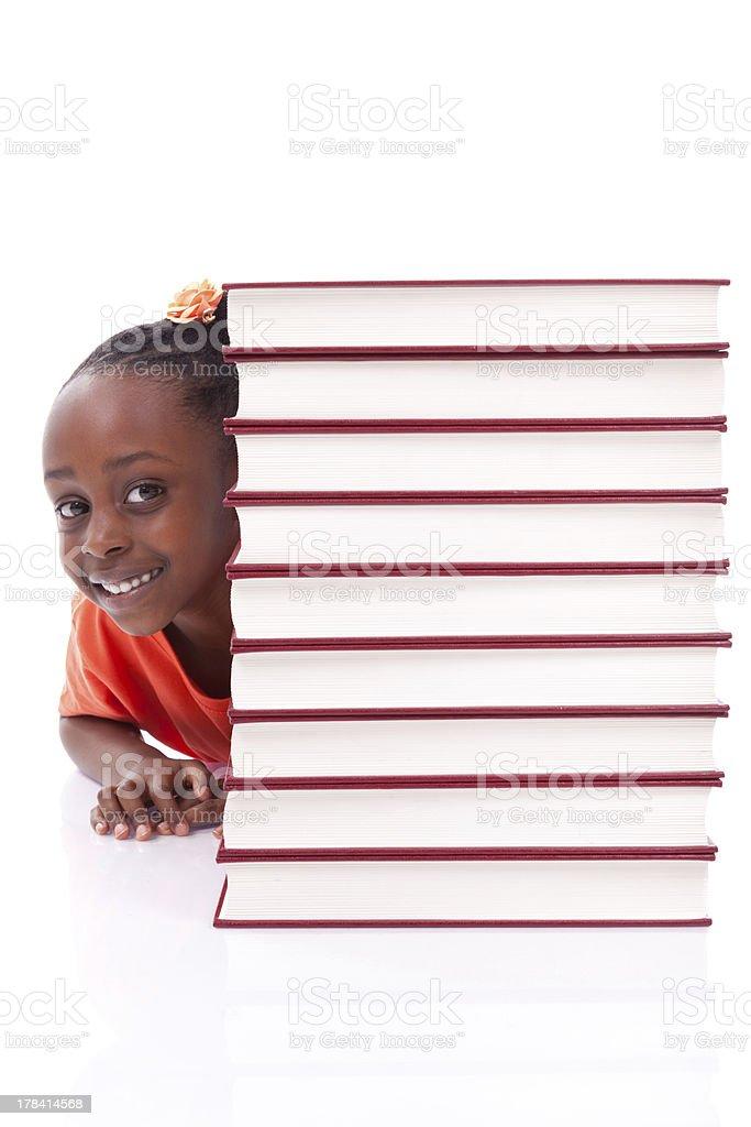 Cute black african american little girl hidden behind books royalty-free stock photo