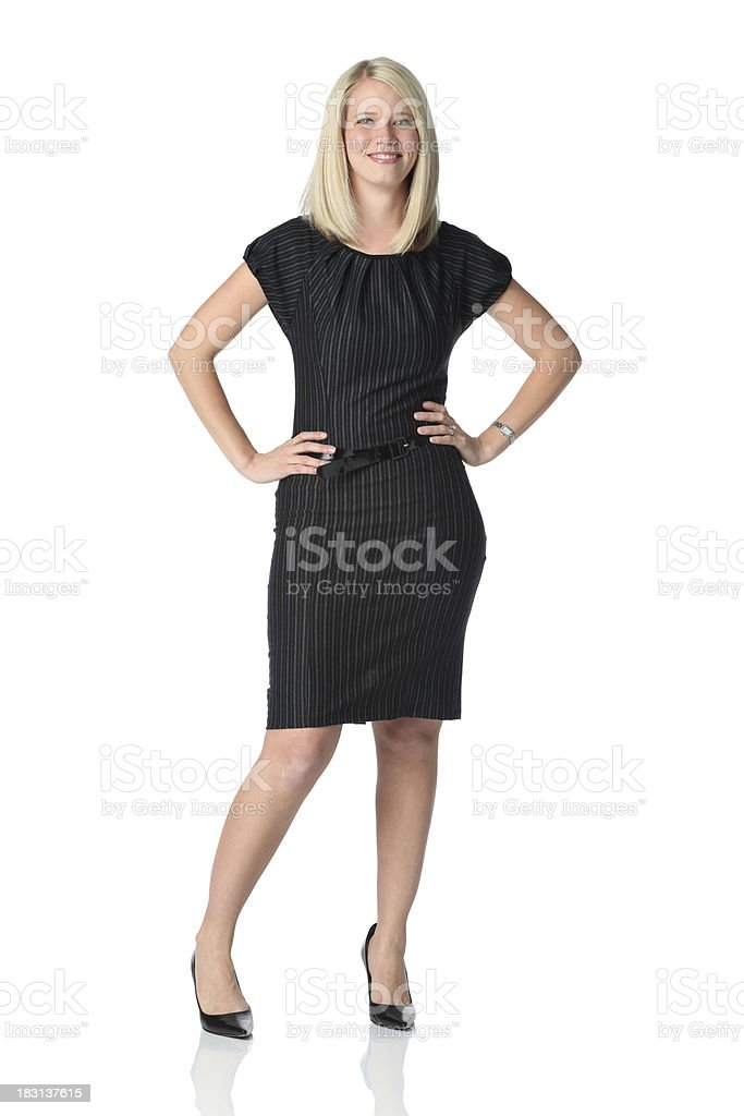 Cute blond businesswoman standing hands on hips royalty-free stock photo