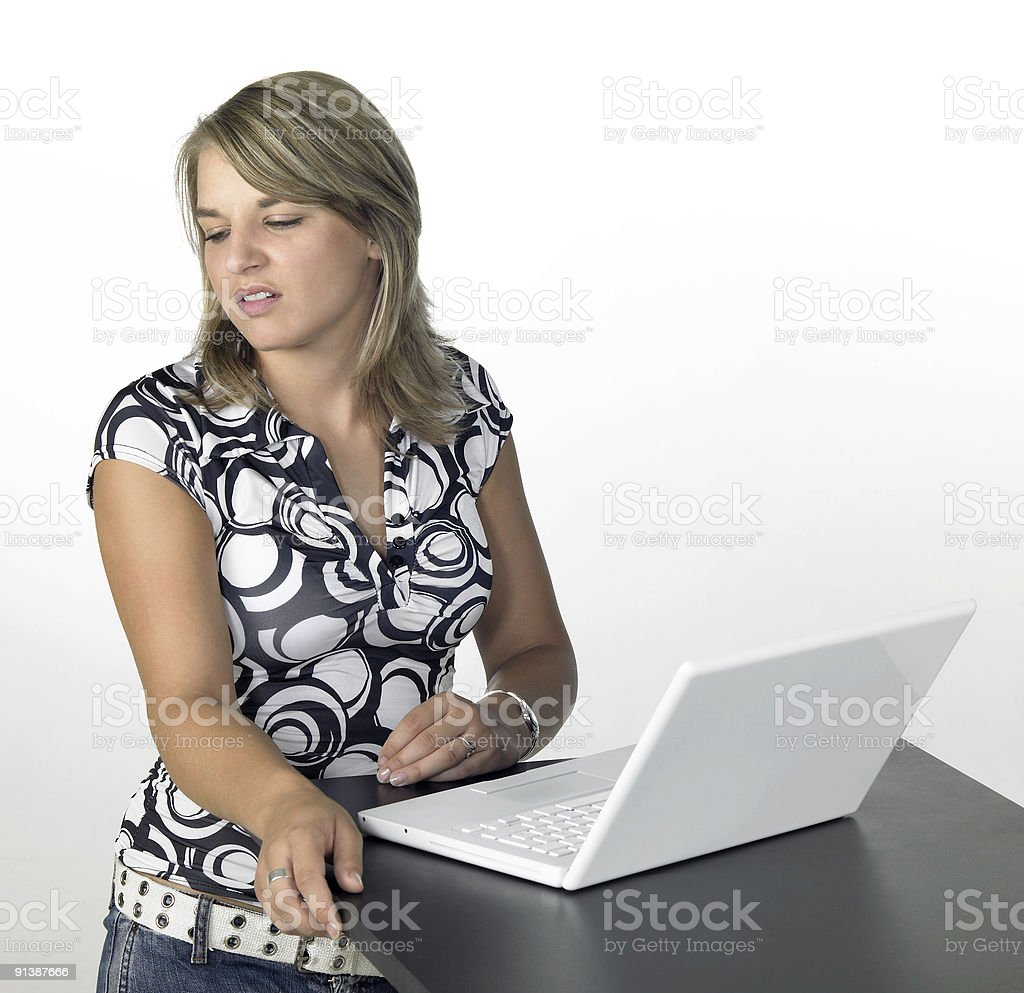 cute blond girl turns away from laptop royalty-free stock photo