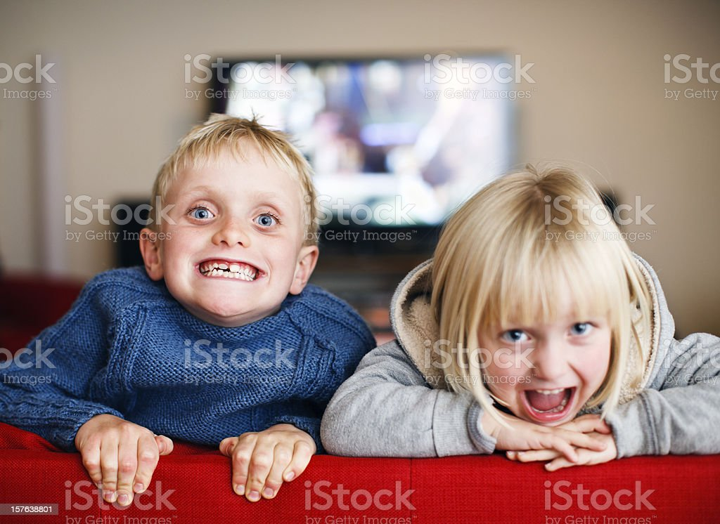 Cute blond siblings happily making faces for the camera royalty-free stock photo