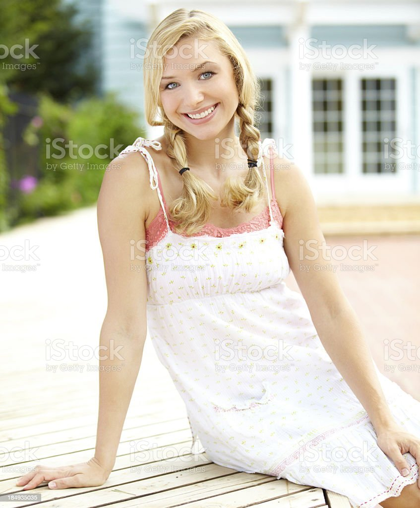 Cute blonde girl in a pretty summer dress royalty-free stock photo