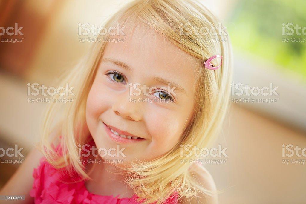 Cute blonde girl smiling at camera royalty-free stock photo