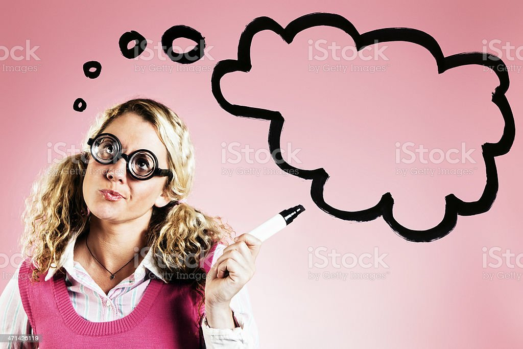 Cute blonde in thick spectacles points to hand-drawn thinks bubble royalty-free stock photo