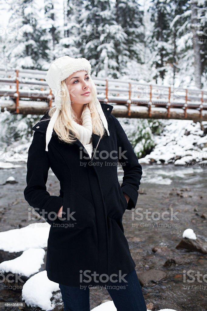 Cute Blonde In Winter Gear In Snow In Mountains stock photo