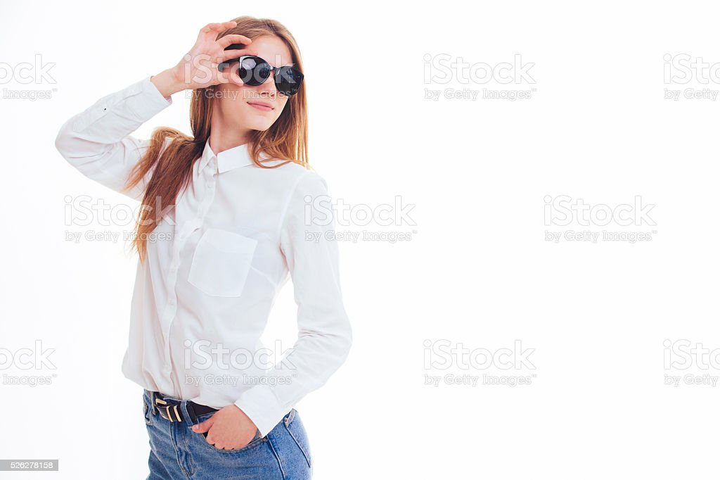 Cute blonde keeps the sunglasses in the Studio. stock photo