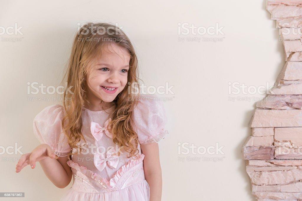 Cute blonde little girl in princess dress stock photo