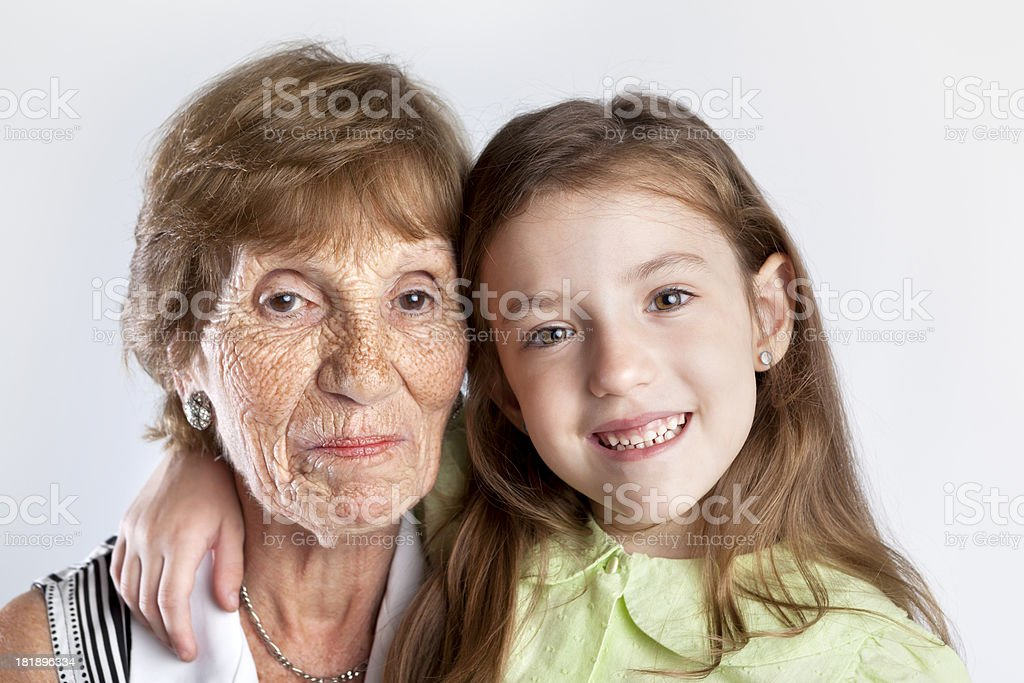 Cute blonde little girl with her great grandmother royalty-free stock photo