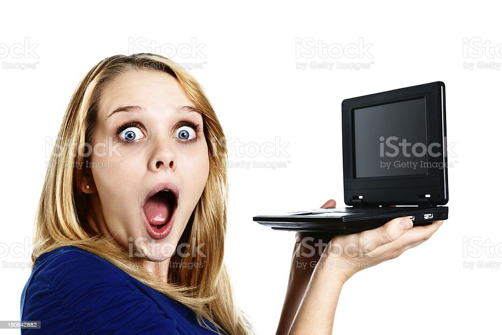 Cute blonde teenager gasps in amazement at netbook computer royalty-free stock photo