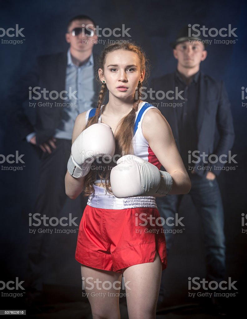 Cute Boxer Girl And Her Sports Agents stock photo