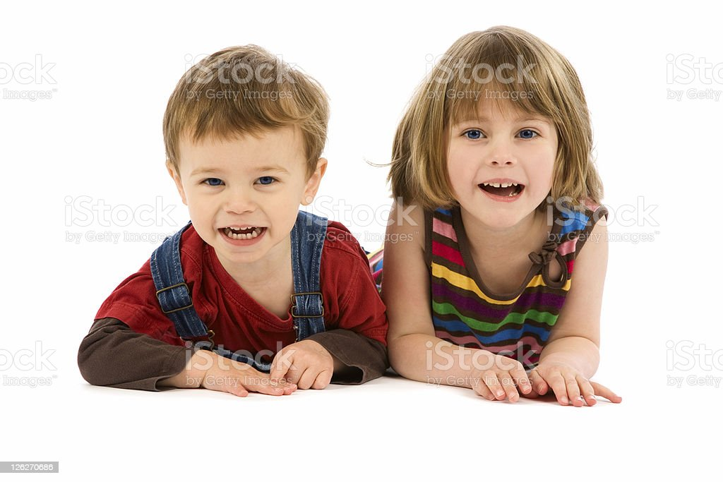 Cute boy and girl lying on white background royalty-free stock photo