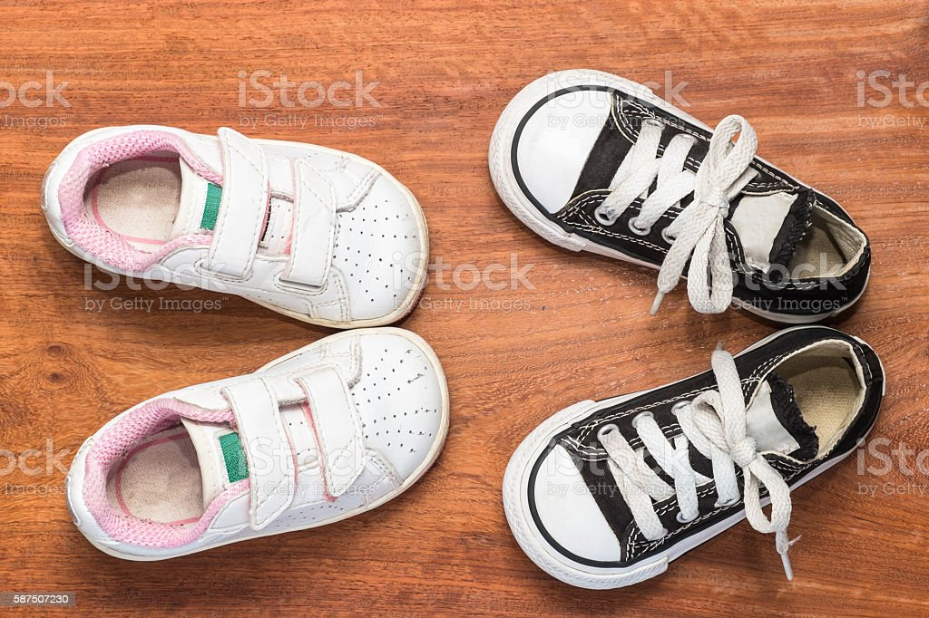 cute boy and girl's shoes. stock photo