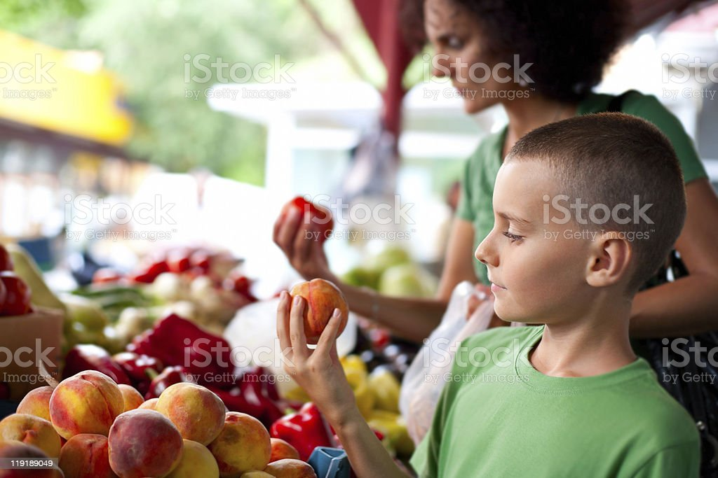 Cute boy and his mom at the farmer's market stock photo