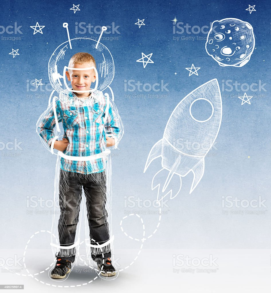 Cute boy as a small astronaut stock photo