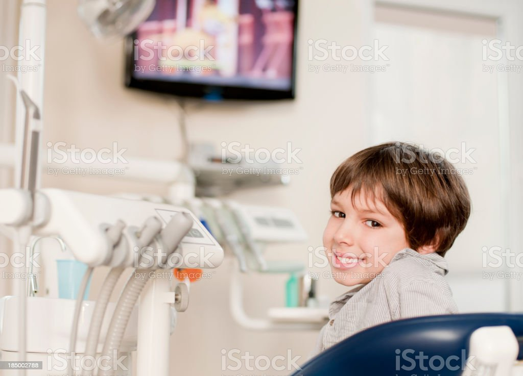 Cute boy at dentist office royalty-free stock photo