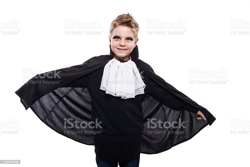 Cute boy dressed up as vampire for the halloween party stock photo