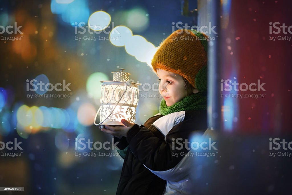 Cute boy, holding lantern outdoor stock photo