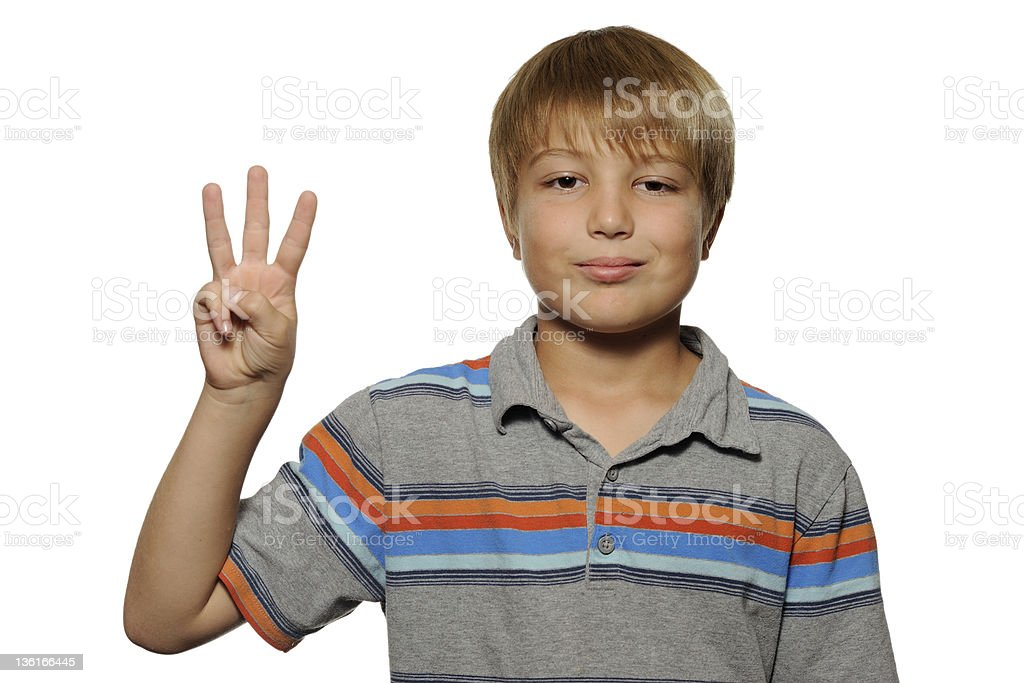 Cute Boy Holding up Three Fingers royalty-free stock photo