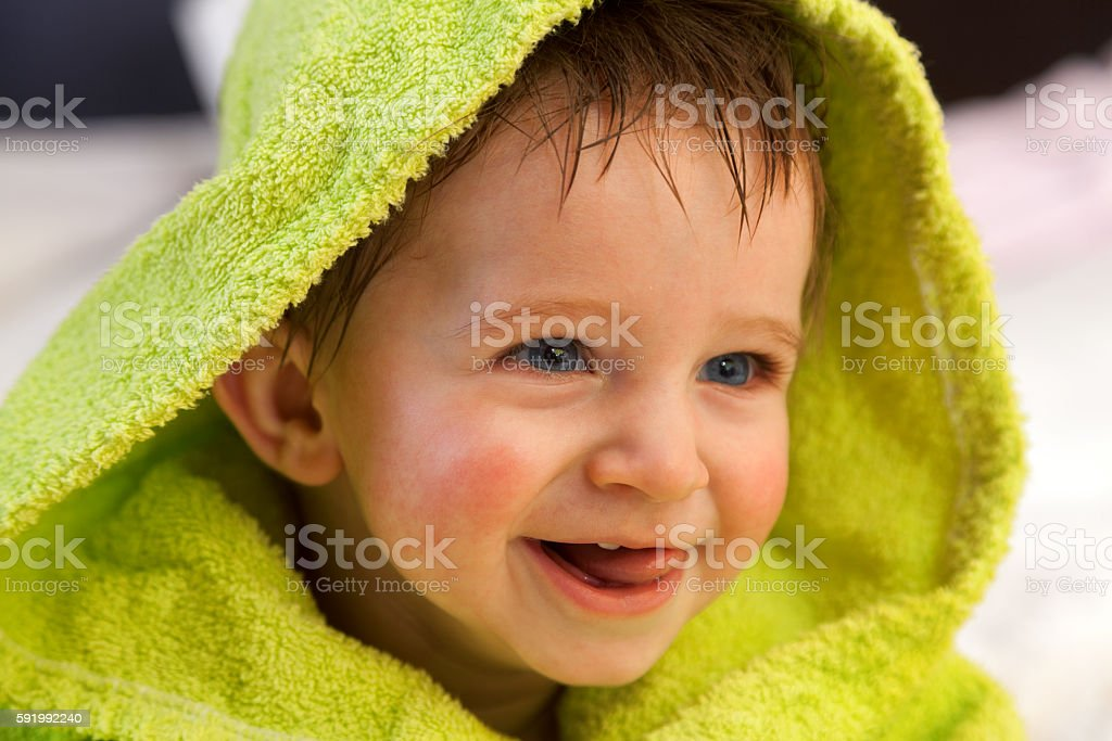 Cute boy in bathrobe stock photo