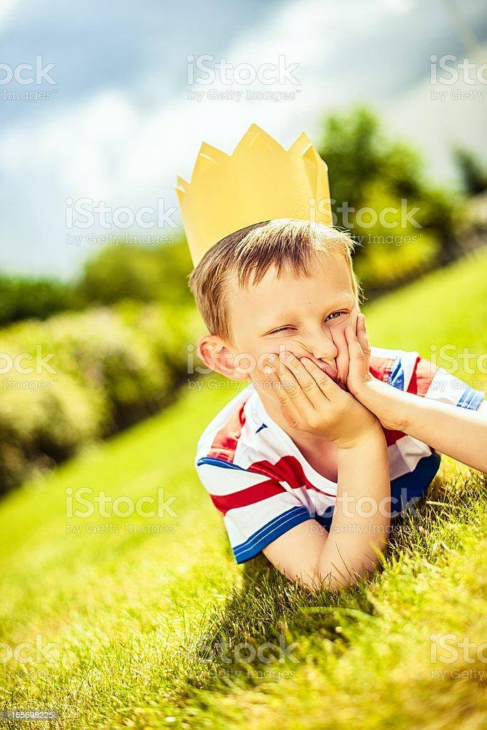 Cute boy in kings crown stock photo