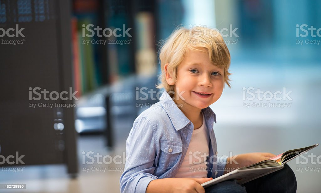 Cute Boy In Library stock photo