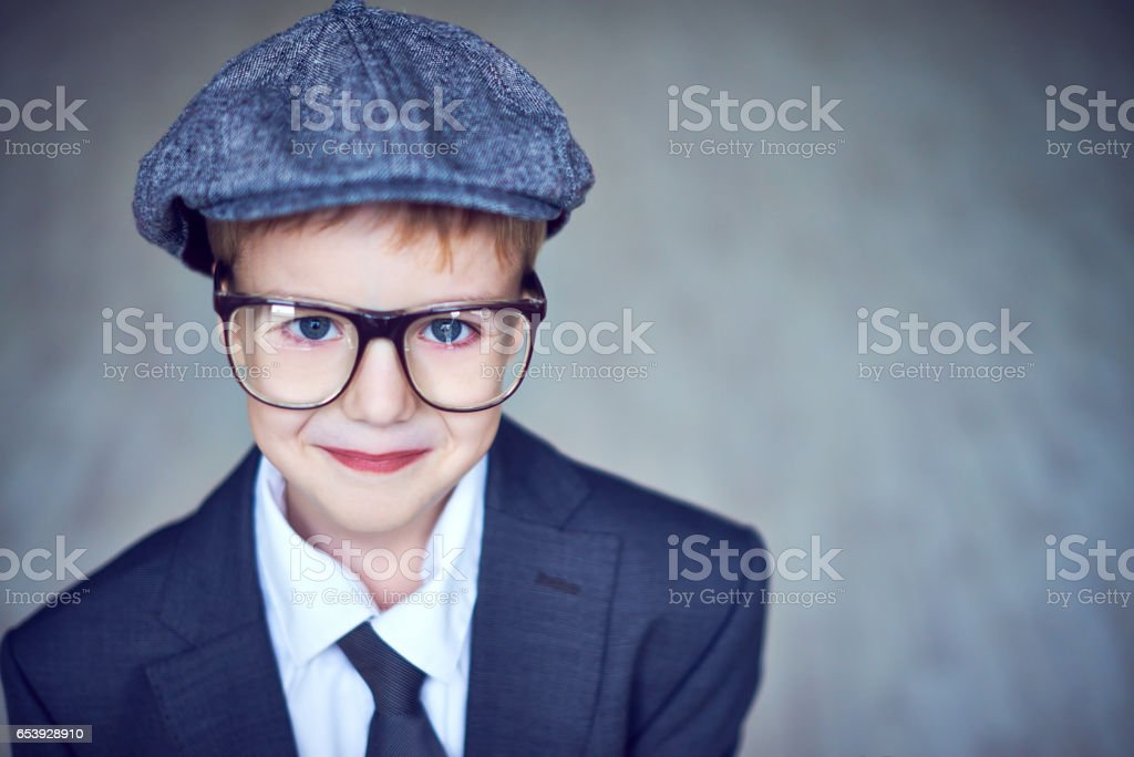 Cute boy in old-fashioned clothes stock photo