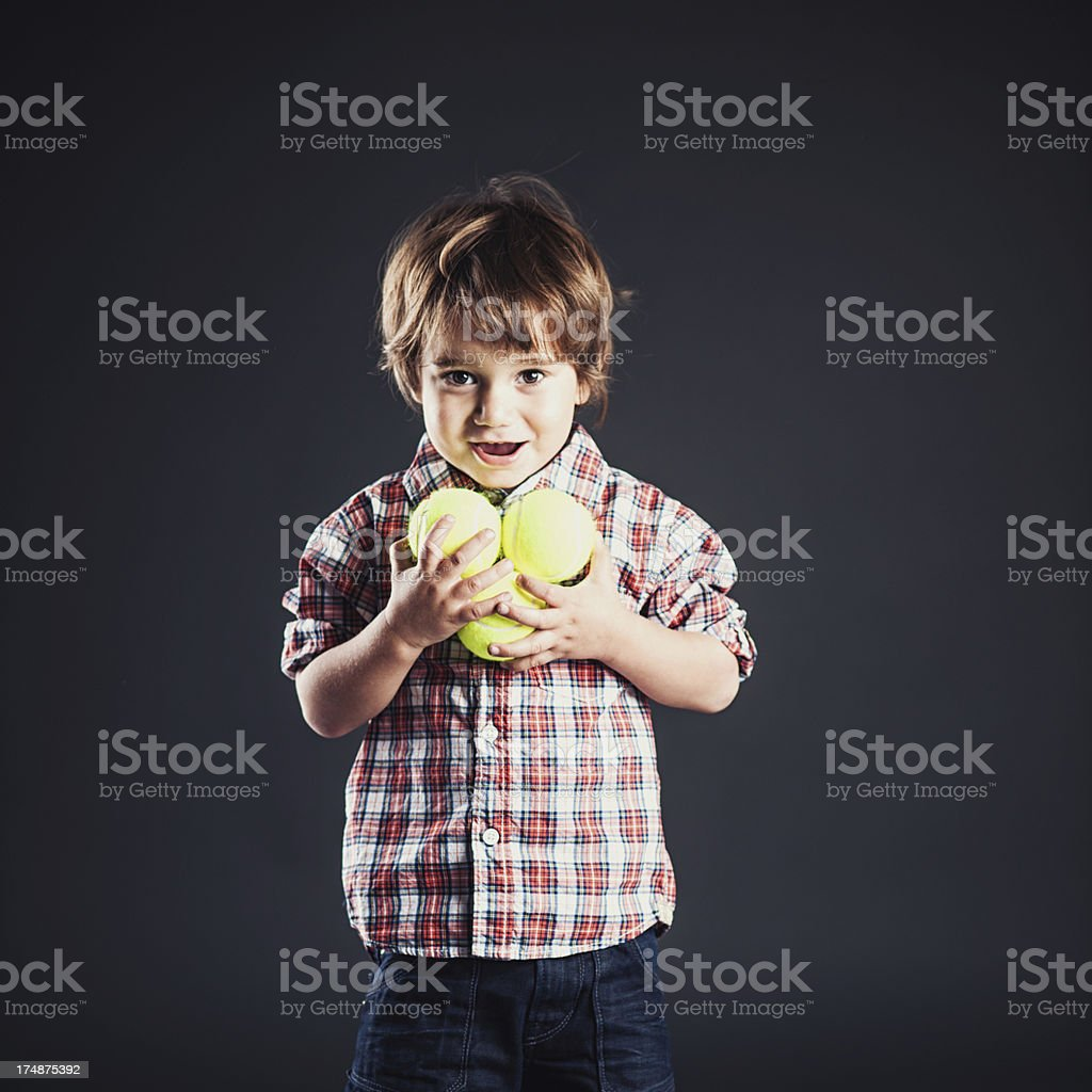 Cute boy looking into camera stock photo