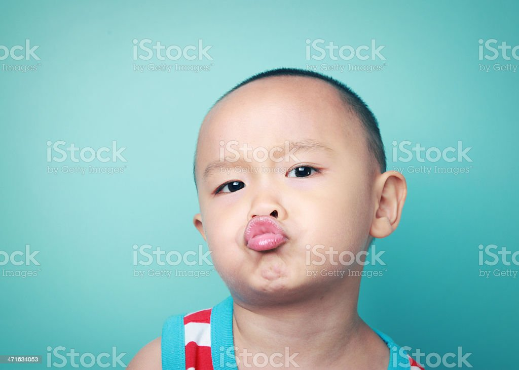 cute boy made faces royalty-free stock photo