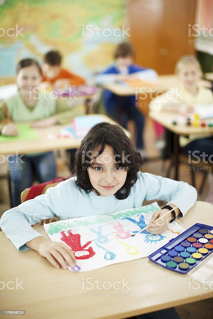 Cute boy making a picture with watercolors royalty-free stock photo