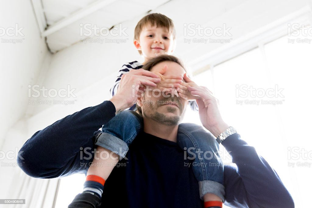 Cute Boy on father's shoulder stock photo