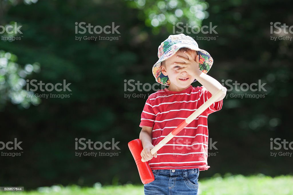 Cute boy, playing croquet stock photo