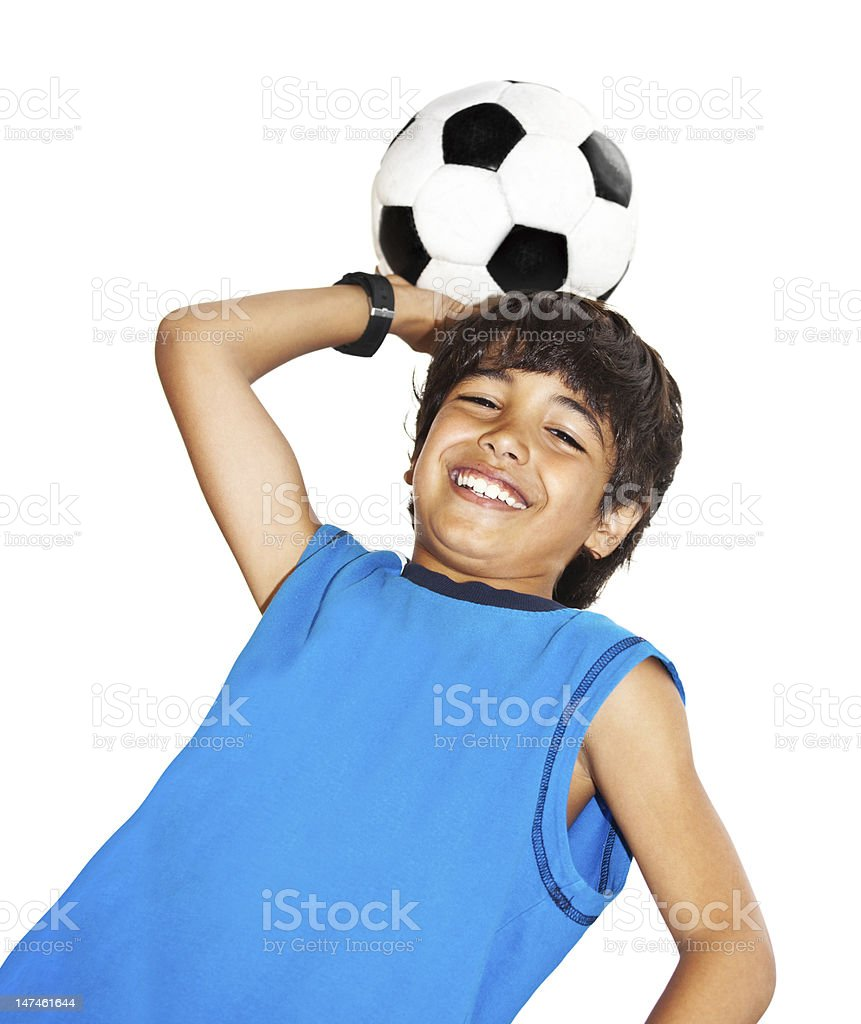 Cute boy playing football royalty-free stock photo
