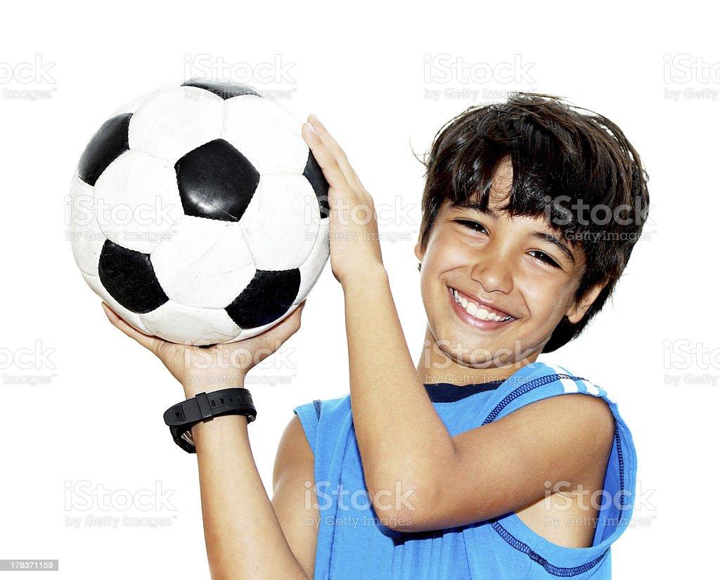 Cute boy playing football royalty-free stock photo