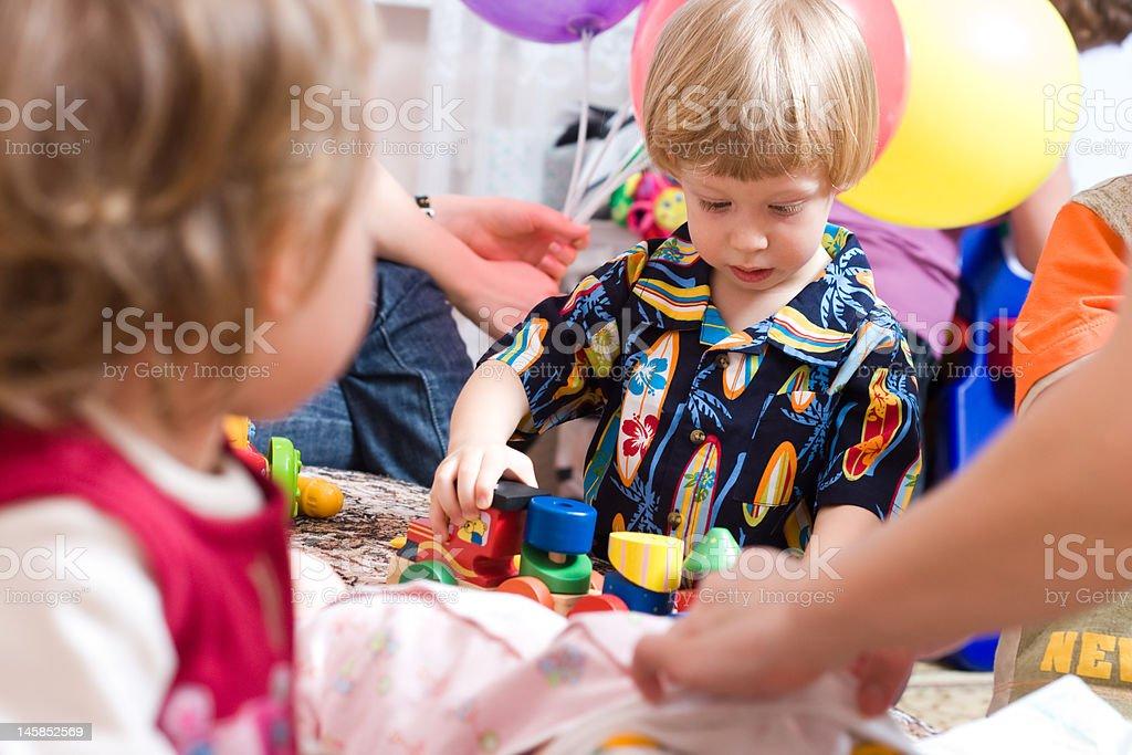 Cute boy playing royalty-free stock photo