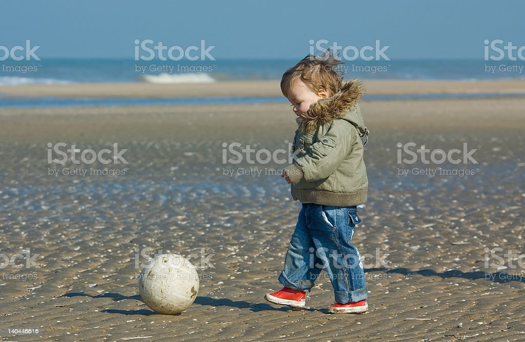 cute boy playing soccer royalty-free stock photo