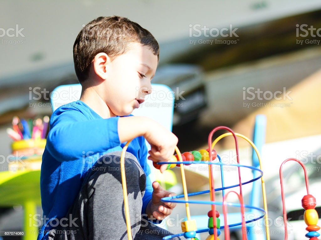 Cute Boy Playing with Education Toys stock photo