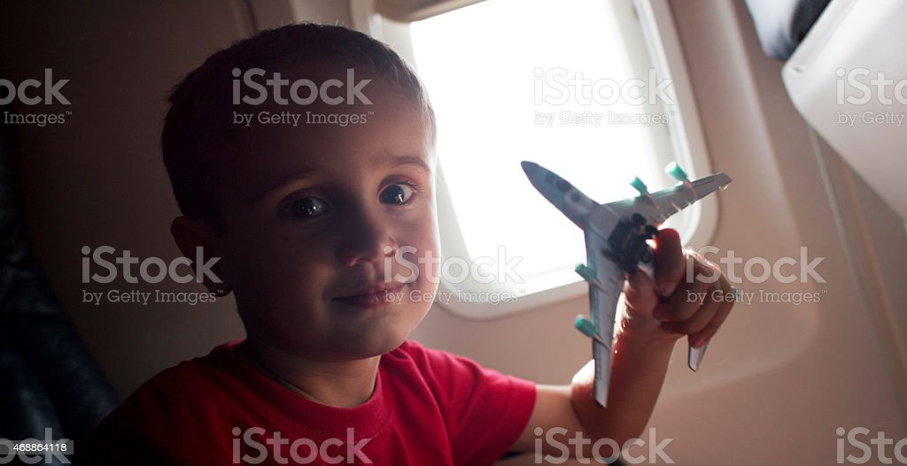 Cute Boy Playing with Toy Airplane stock photo