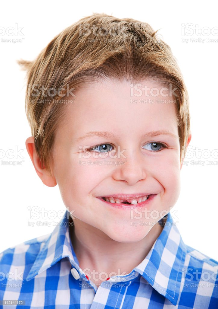 Cute boy showing missing tooth stock photo