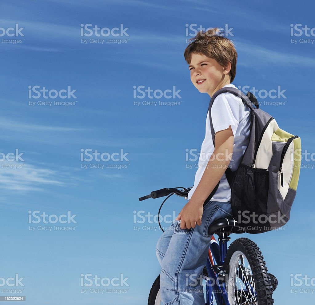 Cute boy sitting on a bicycle royalty-free stock photo