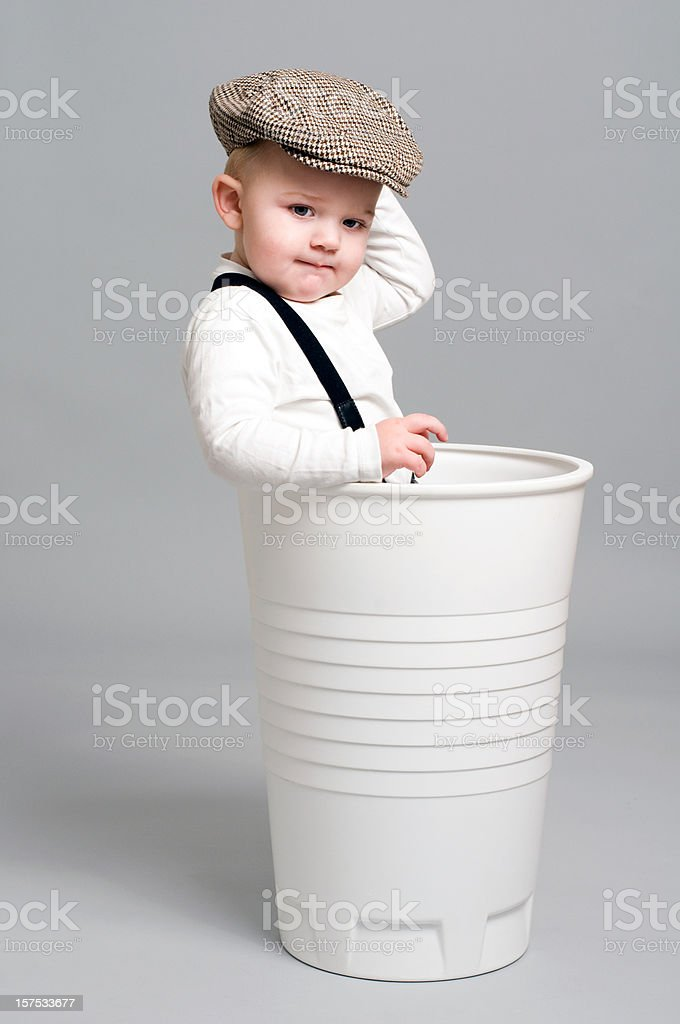Cute Boy stands in a gigant paper cup stock photo